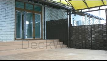 Ограждения из лозы и террасная доска DeckWOOD на террасе